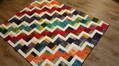 Stairway to Heaven quilt pattern made with scrappy batiks. I made this for our local parish priest for 25th Jubilee.
