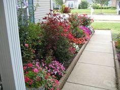 Front walkway garden. Walkway Garden, Front Walkway, Flower Baskets, Walkways, Front Doors, Old Houses, Outdoor Spaces, Outdoor Gardens, Entrance