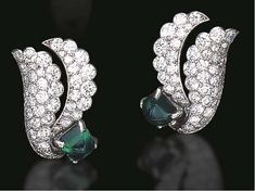 A PAIR OF EMERALD AND DIAMOND EAR CLIPS, BY CARTIER  Each set with a sugarloaf cabochon emerald, extending two circular-cut diamond scalloped scroll motifs, mounted in platinum and 18k white gold, circa 1950, with French assay marks Signed Cartier, Paris, no. 01597  The total weight of the emeralds is approximately 14.90 carats
