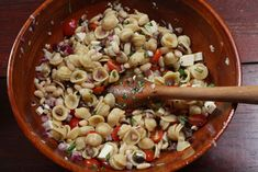 White beans with pasta, olives, tomatoes, basil, and mozzarella cheese. Really classic flavors in a perfect summer salad dish.