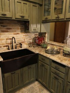 would like this better with a solid countertop, a slate grey concrete countertop would look awesome...But I do love these cabinets and the brick backsplash ..oh and the sink!!!