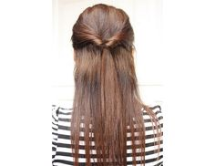 @Byrdie Beauty - To create this quick half-do, take four inches of your hair on each side and tie them in place with a hair elastic. Then, create a hole in the middle and pull your pony through for a pretty update on your classic half-pony.