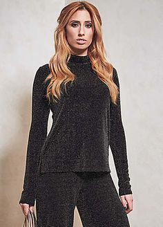 Long sleeved turtle neck top in a stunning all over sparkle Lurex. Perfect for co-ordinating with the Stacey Solomon For Oli Sparkle Trousers. 'Wear these two pieces as shimmering separates or style them together like me for a 70s inspired look' - Stacey Solomon.  Brand: Oli  Washable  87% Nylon, 8% Metallic Yarn & 5% Elastane  Length approx. 62.5 cm (24 ins)