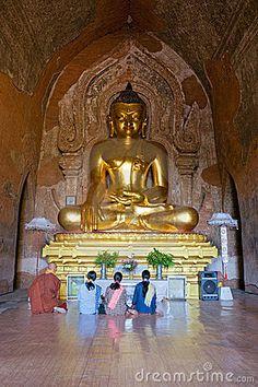Image from http://thumbs.dreamstime.com/x/praying-inside-htilominlo-temple-bagan-12462312.jpg.