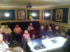 Residents of Care One listen intently.