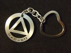 AA Recovery Jewelry Unity Symbol KeyChain - Thick - Sobriety Date. $19.95, via Etsy.