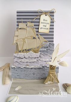 Handmade card by DT member Marleen with Creatables Tiny's Tall Ship (LR0416), Craftables Tiny's Ocean Set (CR1279), Label XL & Labels XS (CR1353) en Punch Die - Sea Shells (CR1363) from Marianne Design