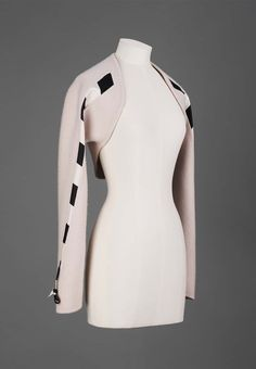 Geoffrey Beene Blonde double-faced wool bolero with black and white striped double-faced silk satin inserts running down sleeves. Fall/Winter 2002