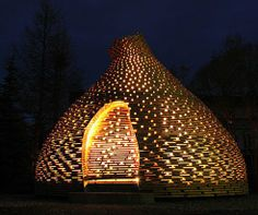 A fireplace dome by Norwegian firm Haugen/Zohar Arkitekter is located in a playground in Trondheim, Norway, the structure doubles as an enclosed place for storytelling around a fire. The conical-shaped hut looks something like a glowing dollop on the landscape.