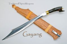 The Gayang is another light, quick, and devastating traditional Filipino weapon, recently added to our combat blade arsenal. Eighteen inches of deadly steel with beautifully carved exotic hardwood handle in an ornate scabbard with locking spring lock retainer.