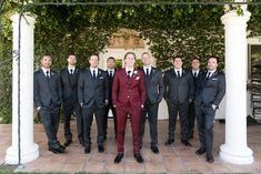 Temecula Wine Country Wedding- Groom in wine tailored suit. Groomsmen in The Black Tux suits