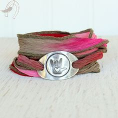 """ I love you"" sign language bracelet, maybe different colors, since I don't like pink"