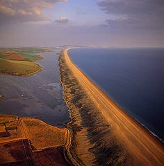 Aerial image of Chesil Beach (Chesil Bank), 29 km long shingle beach, a tombolo connecting mainland to the Isle of Portland, Jurassic Coast, UNESCO World Heritage Site, Dorset, England, United Kingdom, Europe
