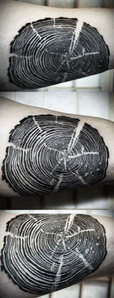 Cool black tree rings tattoo by David Hale