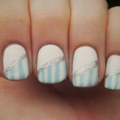 The sweet candy stripes on this manicure are made even better with a stripe of glitter polish. We'd advise nail art pens to get this look.