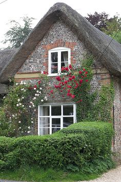Thatched cottage with climbing roses