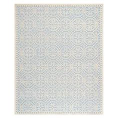 Bring country-chic style to your home with this charming design, artfully crafted for lasting appeal.  Product: RugConstruction Material: WoolColor: Light blue and ivoryFeatures:  Hand-tuftedMade in India Dimensions: 8 x 10Note: Please be aware that actual colors may vary from those shown on your screen. Accent rugs may also not show the entire pattern that the corresponding area rugs have.Cleaning and Care: Professional cleaning recommended