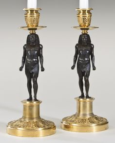 A PAIR OF NEOCLASSICAL GILT AND PATINATED BRONZE CANDLESTICKS MID-19TH C. height 11 in. / 28 cm