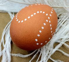 Decorate brown eggs with a simple white water-based paint marker. Love the minimalist look.