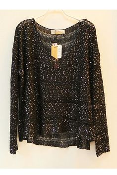 This sweater crafted in acrylics, featuring a v-neckline, sequins embellished to the main, long sleeves, in medium length cut.$41