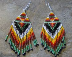These pretty butterfly earrings are done in the brick stitch with size 11 delica glass beads. The colors that I have used are red, black, yellow, orange, and white. They measure 2 1/4 long. The designer is Mary Hipple. I do all of my own bead work one bead at a time. Thank you for looking at my shop. Have a blessed day.