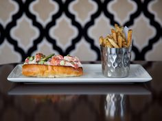 Meet the Lobster Roll- Maine Lobster, Mayonnaise, Paprika, Iceberg Lettuce & Asparagus on a long Brioche Roll. Served with House Cut Fries or Side Salad.