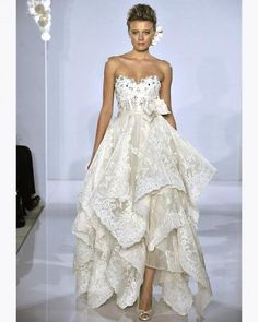 A little much for a beach wedding but this is quite fabulous for a reception dress!!!