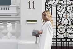 Spotted On Celeb Cape Dress, Grey Chanel Classic Flap Bag, Dior Sunglasses and Givenchy Jewellery