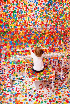 There are many more colorful dots now at Yayoi Kusama's 'The obliteration room' - Gallery of Modern Art (GOMA), Brisbane, Australia. Photo by Stuart Addelsee