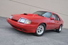 View 1986 Ford Mustang Svo Coyote Vermillion Red Front Quarter Low - Photo 105046466 from Modernized 1986 Ford Mustang SVO is Coyote Perfect