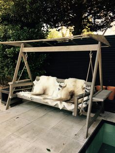 Reindeer hides are great as outdoor chair covers like on this garden swing bench - they are naturally waterproof and insulating when it's cold outside - Sent in by Caroline McKittrick
