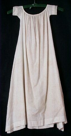 baby's dress, white cotton, short sleeves with sheer cotton embroidered trim, 1855