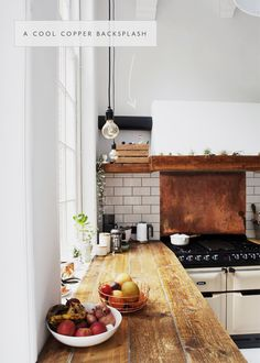 a copper backsplash bring patina and detail to this rustic kitchen | in the details via coco kelley