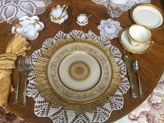 Love using these white crocheted doilies, found in antique stores, as placemats.  I also love these beautiful white an gold plates that I found at an auction. Chargers were bought in a store in my home town( Walker Pharmacy). But I have seen them online. Napkins came from Pier 1... of course.