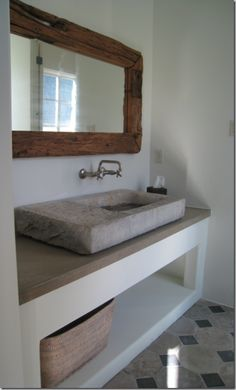 Use this style -- barn wood top with white sink sitting on it, and white wood below to make it more crisp & modern