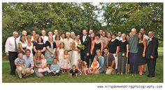 Kingdom Wedding Photography by Kat, wedding formal group photo of all guests at Vermont outdoor wedding