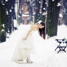 Winter wedding. White dress in the snow. Lovely.