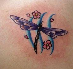 Dragonfly tattoo.