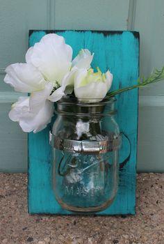 Mason jar wall vase by BluhmsGarden on Etsy. $25.00, via Etsy.