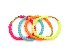 Funk & Fabulous Neon & Gold Bangle Set from Melissa Meyers on OpenSky