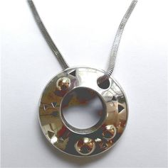 John Atencio Pendant - Designed and signed by John Atencio. Made in Sterling silver and 18kt yellow gold. A250-104. (subject to prior sale) -- Lilliane's Jewelry -- 4101 W. 83rd St. Prairie Village, KS 66208 -- 913-383-3376 –