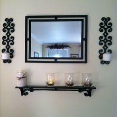 Mirror, shelf and sconces.with yarn candle Coosie, electric tea lights and flowers above the door in background Candle Sconces, Wall Sconces, Electric Tea Lights, Bedroom Ideas, Shelf, Arts And Crafts, Candles, Living Room, Mirror