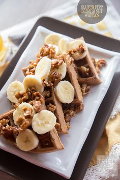 Gluten Free Banana Nut Waffles // These healthy & delicious waffles are the perfect way to start your morning. Made with oat flour, you can have your favorite waffles without any wheat! Topped with maple candied pecans and bananas, they are a treat you don't want to miss!
