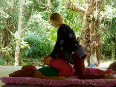 One of many Thai Yoga Massage's assisted stretches... with one knee pressed toward the abdomen, while the other leg is grounded and its energy lines compressed.    (Photo taken at the Koh Ra Ecolodge on the island of Koh Ra in Thailand, February 2012)