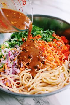 This crunchy Thai noodle salad is smothered in my favorite sesame peanut sauce. It's easy to make and absolutely addicting to eat! You can serve these noodles cold or hot and add even more sriracha for a kick! Asian Cold Noodle Salad, Spicy Asian Noodles, Thai Noodle Salad, Thai Chicken Salad, Sesame Noodles, Easy Cucumber Salad, Healthy Pasta Salad, Kale Salad Recipes, Summer Pasta Salad