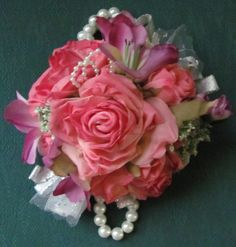 Wrist Corsage for Weddings and Proms Pretty Pink Roses and Purple Accent Flowers by flowerfilledweddings on Etsy