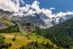 Summer view of the mountains and glaciers of the Ecrins National Park (La Meije and Glacier du Tabuchet) from the village of La Grave. Hautes-Alpes, PACA Region, Southern French Alps, France