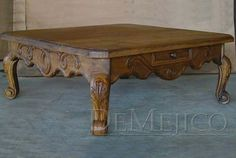 The Mesa de Centro Conquista is a traditional conquista style table hand carved from solid mesquite wood. Description from demejico.com. I searched for this on bing.com/images