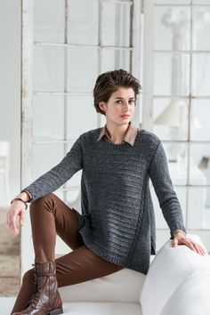 A study in geometric contrasts, this design uses deeply vented side gores to break open an angular pullover striated with Quaker ridging. Cables accentuate the unusual construction. Fitted with gentle ease through the bust and shoulders, Arabella is designed for beauty and comfort. The stockinette gores drape, fold and swing to create alluring movement in …