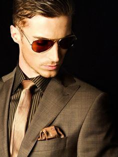 Brown Suit Paired with Gold Accents and Pinstripe Collared Shirt. Sharp!